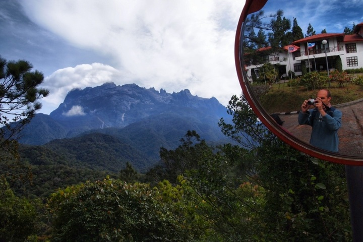 A misty, sleepy dawn rises to reveal Kinabalu and all it's hypnotic majesty*